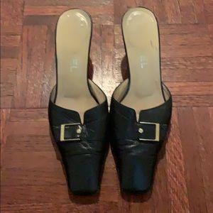 Chanel black leather heeled slides